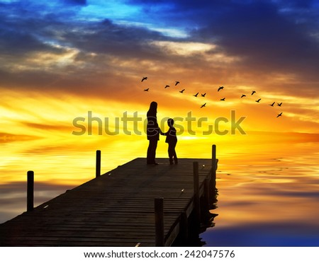 Mother and son on the pier - stock photo