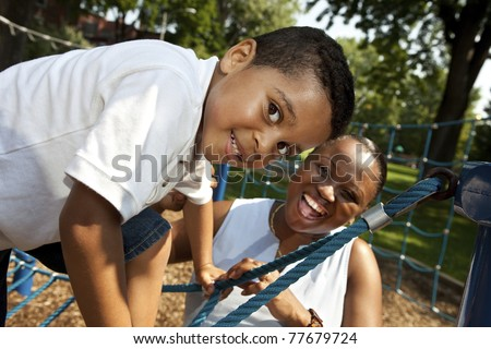 Mother and son playing at a park - stock photo