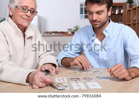 Mother and son playing cards - stock photo