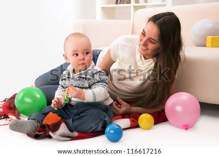 mother and son playing in room