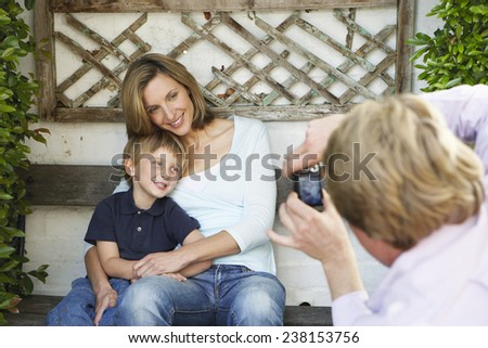 Mother and Son Posing for Photograph - stock photo