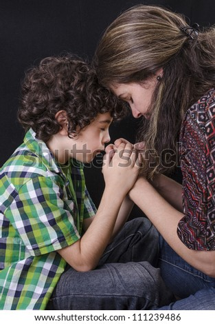Mother and son praying and praising God - stock photo