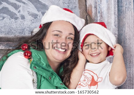 Mother and son ready for Santa - stock photo