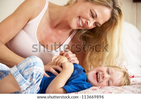 Mother And Son Relaxing Together In Bed - stock photo