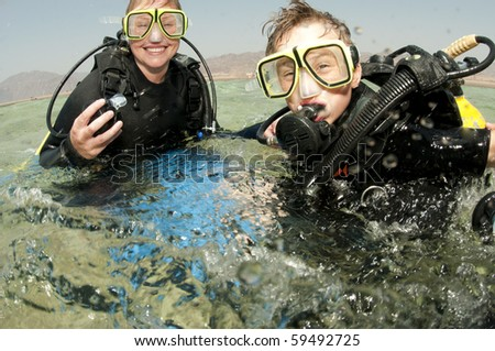 mother and son scuba diving - stock photo