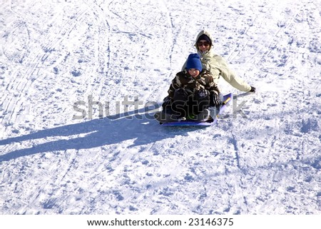 Mother and Son Sledding down the Hill - Winter Scenes