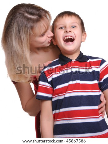 Mother and son son embracing his beautiful young mother - stock photo