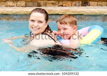 Mother and son swimming together while on vacation