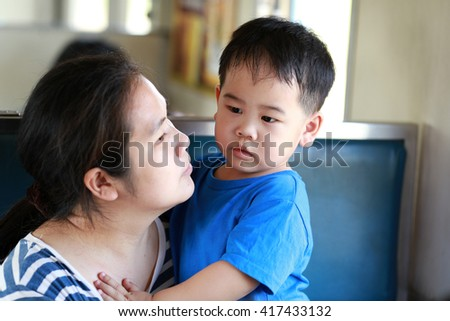 Mother and son travel with train - stock photo