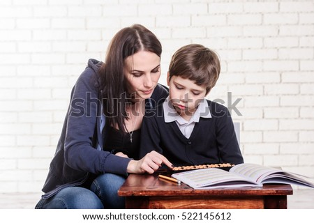 Mother and son using  abacus.