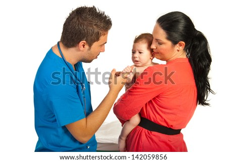 Mother and son visiting doctor  in his office against white background