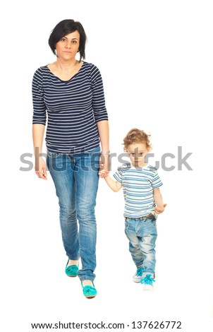 Mother and son walking together and holding hands isolated on white background - stock photo