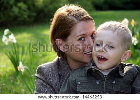 Mother and son whispering - stock photo