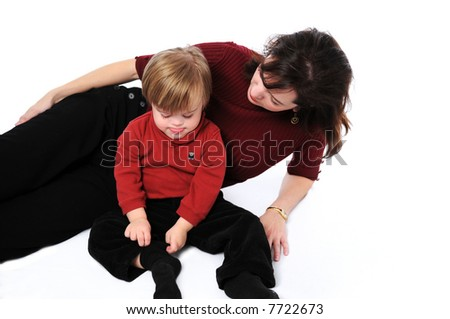 Mother and son with down syndrome isolated on white - stock photo