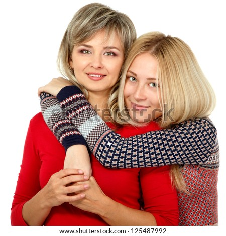 Mother and teen daughter winter portrait over white - stock photo