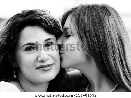 Mother and teenage daughter outside - stock photo
