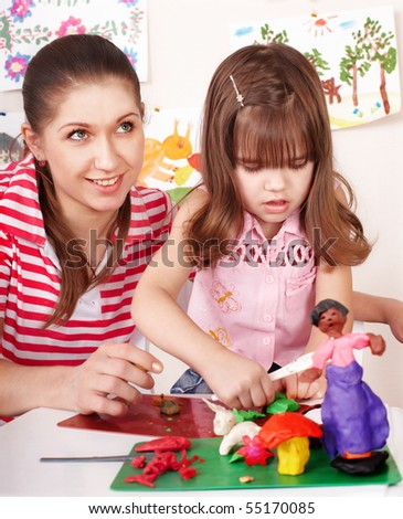 Mother and the daughter mould from plasticine. Child care. - stock photo