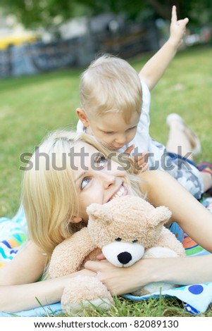 Mother and the small son lie on a meadow - stock photo