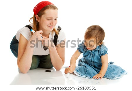 Mother and toddler drawing together on the floor