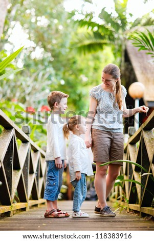 Mother and two kids outdoors at tropical jungle resort