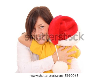 mother and 5-6 years old girl having fun in Christmas hat isolated on white - stock photo