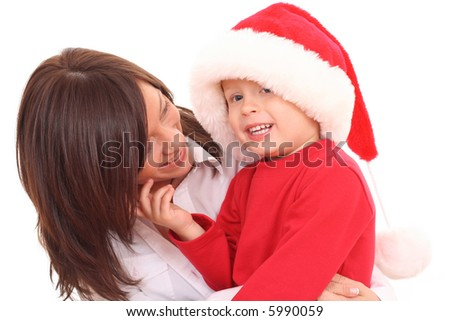 mother and 3-4 years old son having fun in Christmas hat isolated on white