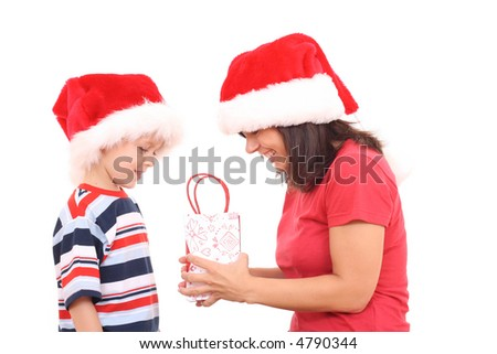 mother and 5-6 years old son having fun in Christmas hats isolated on white