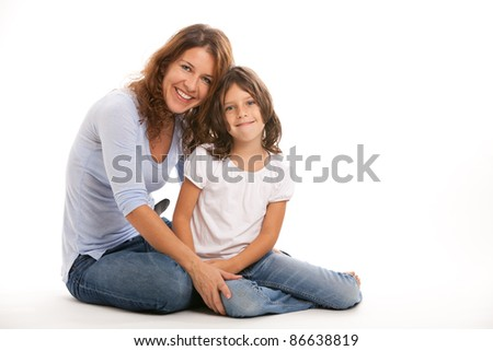 Mother and young daughter in an affectionate pose on a white background. - stock photo