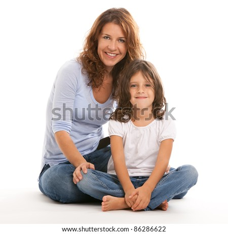 Mother and young daughter on a white background.