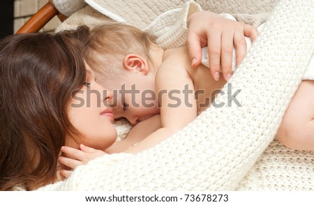 Mother breast feeding her infant - stock photo