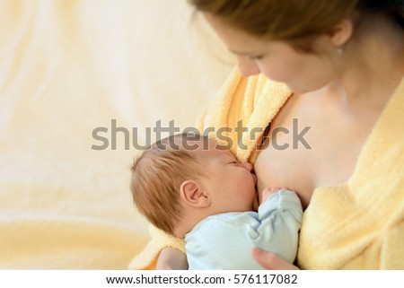 Mother breastfeeding her baby. Healthy lifestyle concept.