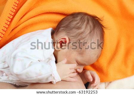 Mother breastfeeding her newborn baby girl - stock photo