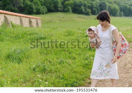 mother bringing her pensive daughter - stock photo