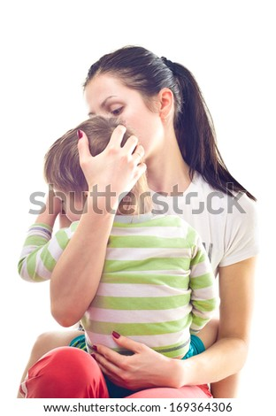 Mother calms a crying child - stock photo