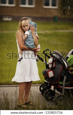 mother calms her crying daughter - stock photo