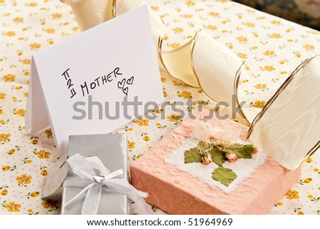 Mother Card with Bows and Gifts - stock photo