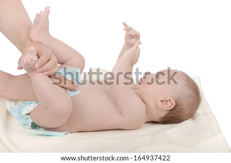 Mother changing diapering her baby the diaper - stock photo