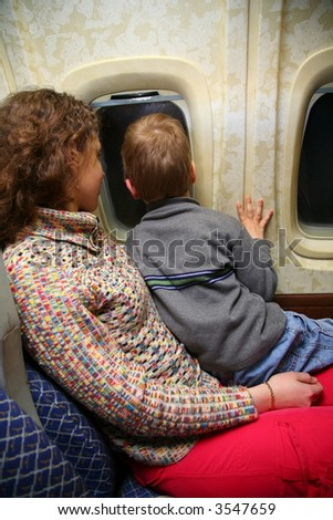 mother child airplane - stock photo