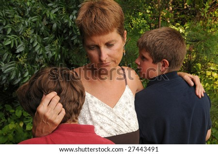 mother comforts crying children - stock photo