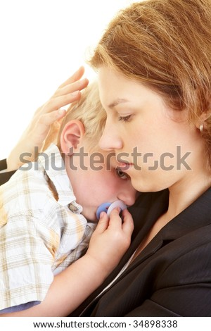 Mother comforts her young son - stock photo