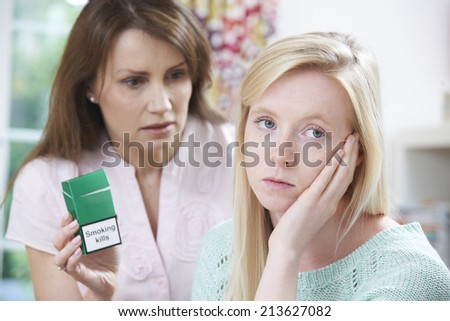 Mother Confronting Daughter Over Dangers Of Smoking - stock photo