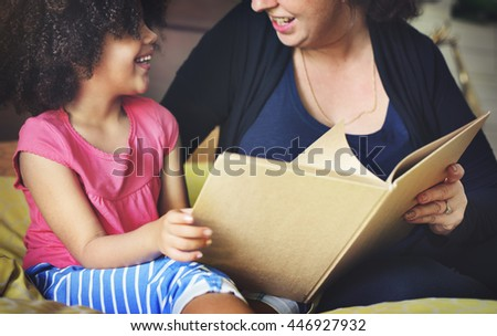 Mother Daughter Bonding Casual Reading Relax Concept - stock photo