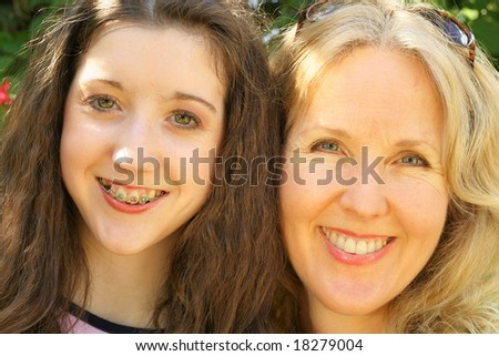 mother daughter headshot upclose - stock photo