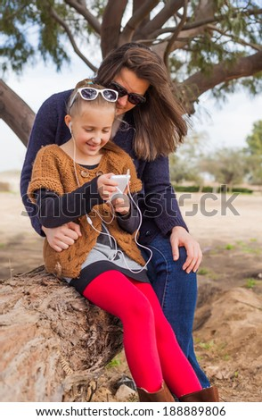 mother daughter on a walk entertaining a summer day - stock photo