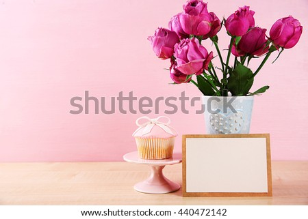 Mother Day concept. Roses with cupcake on pink background - stock photo