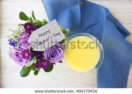 Mother Day greeting on a bouquet of flower with a Mimosa, seen from above.