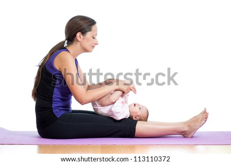 Mother doing yoga exercise with her baby - stock photo