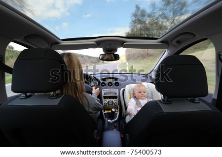 Mother driving car with her baby
