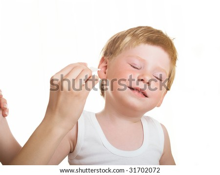 mother earth in the ear drops a sick boy - stock photo