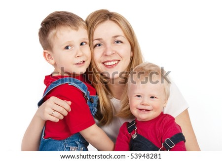 Mother embracing children on white background